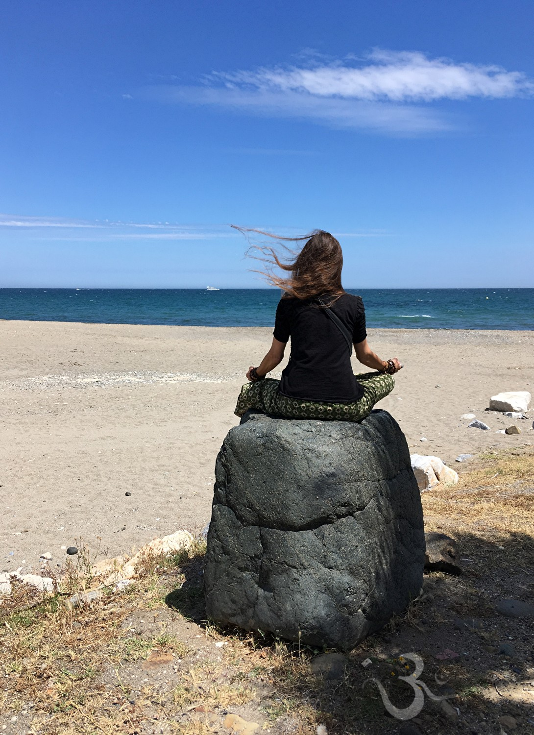 meditation during lunch on the beach of Puerto Banus